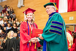 Samantha Chapman receiving her degree from Dr. David Beyer